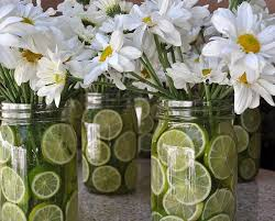 jar table decorations daisies and limes in jar centerpiece