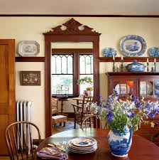 a collection of antique transferware is comfortably displayed in the dining room sideboard and on the plate rail jpg