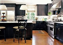 best black kitchen cabinets with white shade pendant lights and