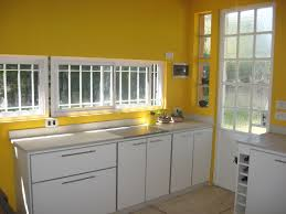 kitchen with yellow walls and gray cabinets grey and yellow kitchen vuelosfera com
