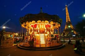antique merry go with the eiffel tower in the background at