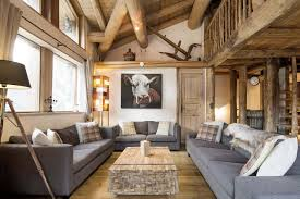 chalet arosa val d isere alpine guru chalet arosa living room with cow picture and contemporary furnishings