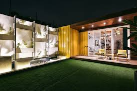 wood turns a shipping container into a stylish home in new delhi