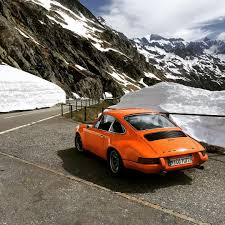 porsche 911 orange last trip before winter sustenpass swiss alps porsche