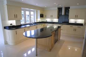 Cream Gloss Laminate Flooring White Modern Cabinetry And Island Using Black Galaxy Granite