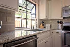 colorful glass tile backsplash blue white cabinets with grey countertops spray painting wood estimate