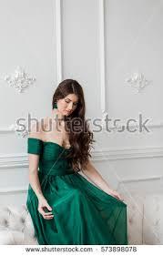 beautiful emerald green dress brunette stock photo 604958489