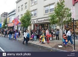 people in costumes walking down ferry street in newark new jersey
