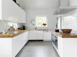 i like the wall scandinavian kitchen style for my next kitchen well helllllllo glossy white cabinets white subway tile and gorgeous butcher block counter tops