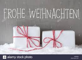 german text frohe weihnachten means merry two white stock