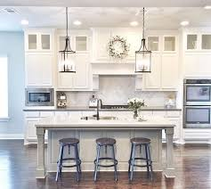 white kitchens with islands outstanding side side white kitchen islands with honed black marble