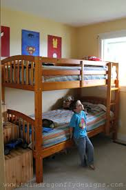 superhero bedroom reveal dragonfly designs decided stack the bunk beds give boys more room play floor superhero paintings are hung high wall protect dreams