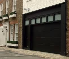 wonderful garage design of a classic english house with white wonderful garage design of a classic english house with white painted brick walls black sliding door elegant doors i