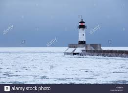 winter view of the north pier lighthouse on lake superior in