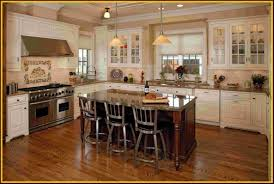 white kitchen cabinets with dark floors kitchen island in the