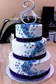 purple and turquoise wedding cake decorating of party