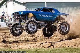 mud sweat gears monster truck drivers hit dirt track
