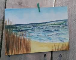 sea grass watercolor painting ocean blue clouds gold sand