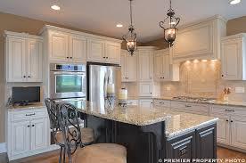 glazing white kitchen cabinets glazed white cabinets dark island travertine backsplash lantern