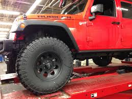 lifted jeep red ome 4 inch jk lift on road review 4waam