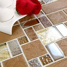 brown porcelain floor tiles yellow crystal glass tile backsplash