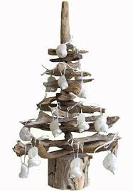 make a christmas tree with driftwood completely coastal