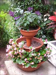 graceful tiered indoor planter design with tubular iron framework