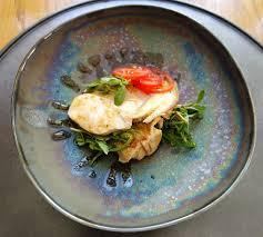 photo plat cuisine gastronomique plat de poulet servi dans le restaurant gastronomique photo stock