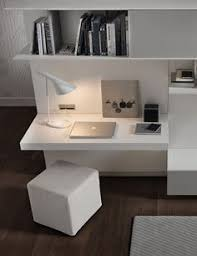 trendy wall unit system for the living room in minimalist white