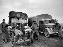 opel blitz maultier soldiers from the 5 ss panzer division repairing a pumptured wheel