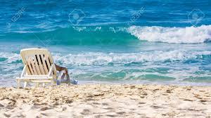 Chairs On A Beach Woman Sunbathing In A Plastic Chair On A Beautiful Beach In Cuba