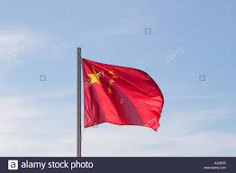Flag With Yellow Star Chinese Flag Flying In Bright Blue Sky Background Red Flag With