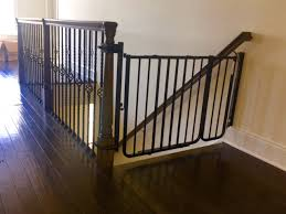 Child Stair Gates Baby Gate Mounted At Bottom Of Stairs Using A No Holes Banister
