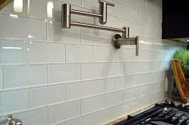glass subway tile backsplash kitchen glass subway tiles kitchen transitional with cabinet doors lever