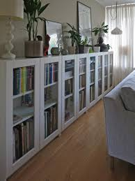 bookshelf with glass doors traditional interior design with