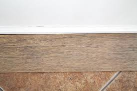 Laminate Flooring Vs Tile Our Flooring Solid Wood Vs Faux Wood Tile Chris Loves Julia