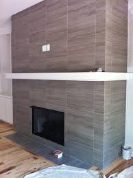 12x24 porcelain tile on fireplace wall and return walls floor