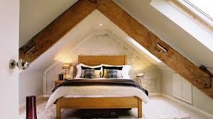 good rustic attic bedroom that features amazing forest view about