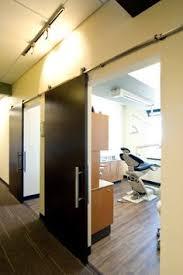 Paneled Hallways And Organic Light Fixtures Dental Office Design - Dental office interior design ideas