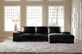 Leather Sofa Small L Shape Black Leather Sofa On The White Fur Rug Combined With
