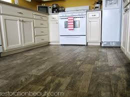 Laminate Floor To Tile Transition Restoration Beauty Faux Wood Tile Flooring In The Kitchen