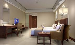 interior buff modern hotel bedroom alongside brown platform bed