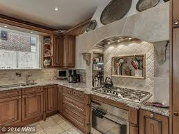 kitchen rustic kitchen green cathedral ceiling u shaped kitchen kitchen rustic kitchen green high ceiling l shaped kitchen peninsula limestone complex marble counters chandelier