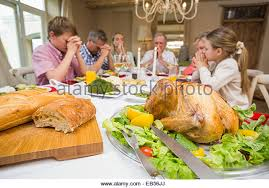 family saying grace meal stock photos family saying grace meal