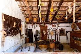 old fashioned kitchen old fashioned kitchen with ancient dishes and hanging garlic stock