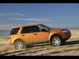 land rover desert 2008 land rover lr2 tambora flame side desert 1024x768 wallpaper