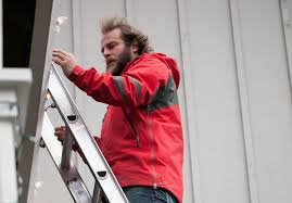 red hat lighting installs maintains christmas lights the columbian
