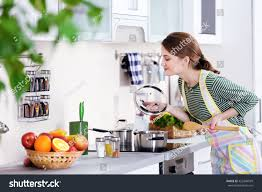 young woman cooking kitchen stock photo 422846599 shutterstock