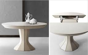 expandable round dining table opera a round expandable modern dining table by bauline