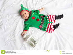 baby in elf costume for christmas holiday on white stock photo